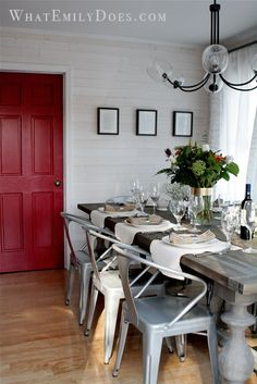 beautiful wood table, industrial tabouret chairs, red door, black accents