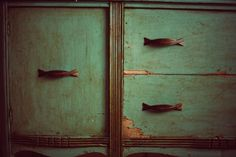 Rustic teal painted wooden dresser.