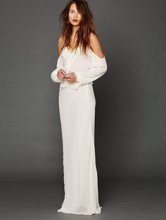 """Free People Temptress Cold Shoulder Maxi, $608.00 White 100% silk chiffon long-sleeved maxi dress with exposed shoulders. Bead embellishment around neckline. Ruffled fabric trimming around neckline, back, and waist. Deep """"V""""-back. Adjustable shoulder straps. Zips up lower back. Lined."""