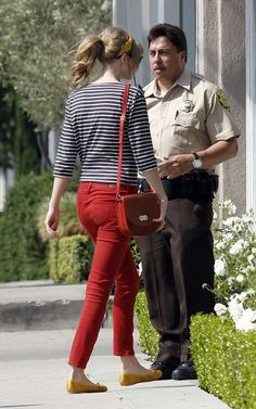 Taylor Swift color coordinates her red lipstick with red pants and a  stripped shirt as she goes jewelry shopping at Neil Lane Jewelry store