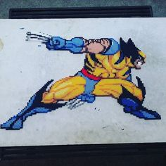 Wolverine perler beads by Eric Kelly Perler Patterns, Bead Patterns, Melty Bead Designs, Minecraft Perler, Pixel Art Grid, Pixel Beads, Dc Comics Characters, Patchwork Patterns, Crafty Craft