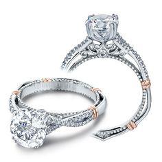 A glittering diamond and an inventive band design make a chic, stylish statement  #roundcut #diamondrings