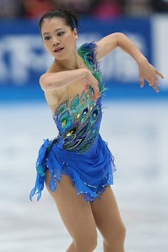 Such a stunning inspiration for an skating dress. Peacock tones on blue. Choose the best blue base for your skin tone first. Then the peacock tones will go on just about any blue.
