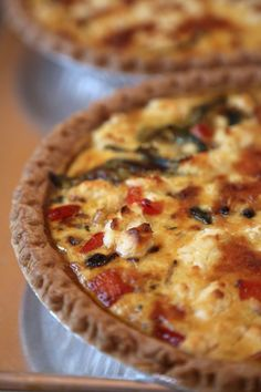 One of the best parts about this vegetarian Mediterranean quiche is that you can enjoy it no matter what time of day. Sautéed onions, zucchini, red peppers, and sun-dried tomatoes mix with gruyère and goat cheese for a richness that will be Quiches, Mediterranean Diet Recipes, Mediterranean Dishes, Mediterranean Quiche Recipe, Lebanese Recipes, Croatian Recipes, Hungarian Recipes, Cooking Recipes, Healthy Recipes