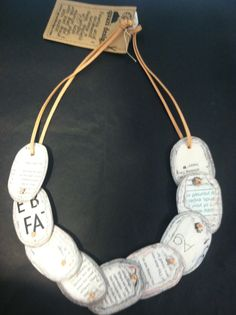 Necklace made from recycled books.