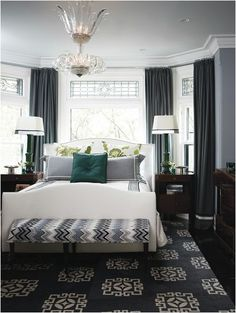 there are so many things I like about this bedroom. the teal accent pillow. the patterned euros. Incorporating the gray wall color in shams...