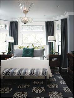 bed under window in gray bedroom houseandhome
