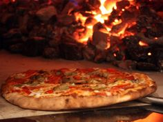 The great pizza battle has raged nationwide for decades. Being so close to Chicago, you may be in the deep-dish camp and think your pizza. Brick Oven Pizza, Wood Fired Pizza, Italian Catering, Pizza Company, Fire Pizza, Pizza Pizza, Great Pizza, Super Bowl Sunday, Tasty