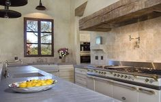 Ivory enamel on lacanche cooker with Creamy Balzac limestone counter tops