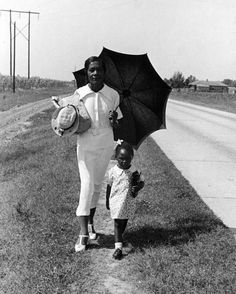 Sunday School | 1938    African-American woman walking her daughter to Sunday school on a road between Memphis, TN and Clarksdale, MS. Alfred Eisenstaedt, 1938. Life Photo Archives, © Time Inc., Courtesy of LIFE.com    Find Us On Twitter | Facebook | Tumblr