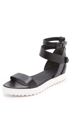 Loving the Alexander Wang 'Jade' black flat sandals with a lug sole in a contrasting white rubber $315, get it here: http://rstyle.me/~BHXK