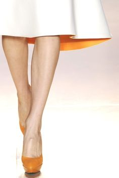 Perfect skirt length, perfect legs. Orange accents.