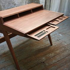 Laura Desk by Phloem Studio. A huge amount of division of storage, nice idea but could be quite constricting.