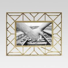 With the Geometric Gold Single Image Frame from Threshold™, you'll be able to add sleek style to your favorite family photo or vacation snapshot. This frame has a unique wire geometric design that adds the perfect spark whether it's sitting on your bookshelf or added to your nightstand.