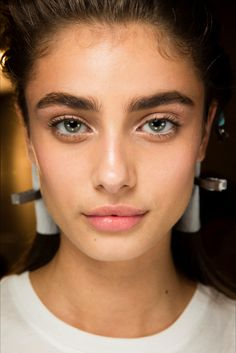 Bold brows and simple, understated makeup