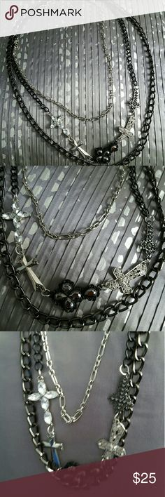 3 in 1 silver and black crosses and chain necklace NWOT. This 3 layered silver and black chain necklace has a very unique biker chic style. Crosses are very blingy and flashy to go along with other jewelry.  Very secure clasp as shown in pictures. Questions just ask. Jewelry Necklaces