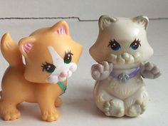 """littlest pet shop toy 90s toy - i had this one it was 4 cats and a """"4 roomed"""" tall house. each animal did something. the greys' arms moved when you pulled the tail like """"scratching"""" at a post and oranges' head bobbled. one had Velcro to """"climb"""" up the side of house (his room was on top) cant remember the last one. just loved these!!"""