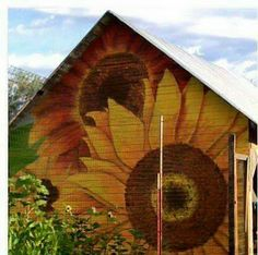 Sunflower painted on the back of a barn