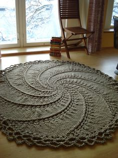 Hand Knitted Natural Linen Rope Cord Rug Spiral with crochet edge. $250.00, via Etsy.