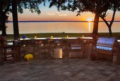 Enjoy a classic sunset while cooking out with an outdoor kitchen created using Stonegate wall blocks.