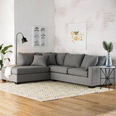 Anchor your living room seating group or parlor ensemble with this eye-catching sectional sofa, featuring neutral-toned upholstery and a streamlined design.