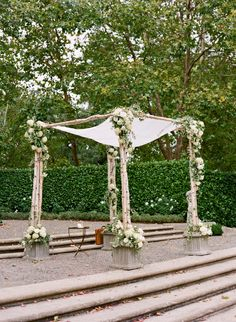 chuppah - just front posts, not the base much  less flowers would be fine, but overall shape of florals is great.  This is my favorite look