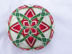 """2.5"""" diameter, white sewing thread, gold marking lines, various shades of red and green pearl cotton.   For Mom H."""