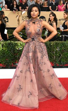 Taraji P. Henson from SAG Awards 2017: Best Dressed Celebs  The 2017 SAG Awards are here, and so are the following major fashion moments.The Hidden Figures actress contrasted how feminine and sexy her Reem Acra gown is with a partially shaved head. Can you say badass?