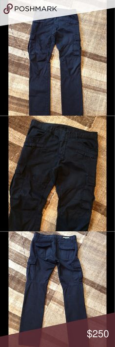 """Balmain cargo pants Very nice navy blue cargo pants by Balmain in size:34 waist: 17 1/2""""; Hip:21""""; inseam:34""""; very bottom leg opening: 7 1/2"""" it have one stain in the front (see pic.5) I'm using eco friendly cleaner, but if you use regular one I'm sure can be removed. Balmain Pants Cargo"""