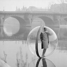 'The Bubble Girl in Paris' by Melvin Sokolsky for Harpers Bazaar Spring Collection 1963.  Part 3 of @georginakevans' image selection. This series was inspired by Hieronymus Bosch and his painting 'The Garden of Earthly Delights'. 'If you look at his painting... you will come across a nude couple in a bubble. That image stayed with me from childhood' says Sokolsky. by showstudio