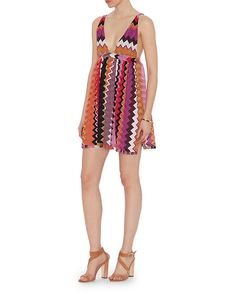 Missoni Mare Baby Doll Lurex Knit Dress: A baby doll dress silhouette with sweetheart neckline, straps, slits at sides of bodice and fringe trim at hem. In pink. Fabric: 64% rayon/23% rayon cupro/13% polyester Made in Italy. Model Measurements: Height 5'10 1/2; Waist 24 ; Bust 31 wearing size ...