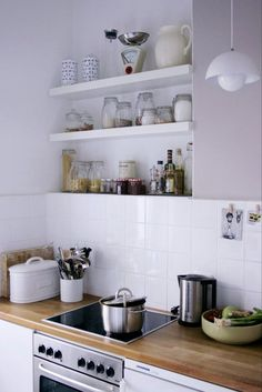 I really like white cabinets, timber benchtops, and square tiles - voila!