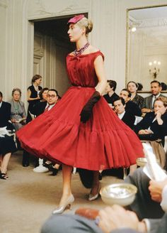 "Statuesque France presents Dior's cocktail/dance dress called ""Haiti"", Autumn/Winter H-line collection 1954, photo by Mark Shaw, Maison Dior, Paris."