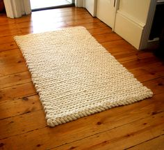 Crochet Rug: chunky cream pure wool Wondering if the Tunisian Crochet simple stitch could create this....