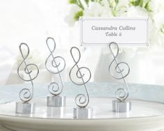 """Love Songs"" Silver-Finish Music Note Place Card/Photo Holder (Set of 4) http://www.1weddingsource.com/store/index.php/love-songs-silver-finish-music-note-place-card-photo-holder"