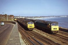 APR 74 1056 Western Sultan passes two classmates as it approaches Penzance with the from Paddington. Electric Locomotive, Diesel Locomotive, Steam Trains Uk, Uk Rail, Railroad Pictures, Train Pictures, Electric Train, British Rail, Train Engines