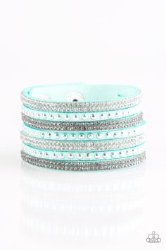 Victory Shine - Blue Bracelet - $5  Shiny silver studs and rows of smoky and glittery white rhinestones are encrusted along strips of blue suede, creating sassy shimmer around the wrist. Features an adjustable snap closure.  Sold as one individual bracelet.