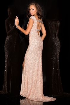 Full length beaded gown with slight capped sleeves and open back. The body of the dress is covered in small self coloured sequins, with diamante bead around the neck and across the bands at the back. The dress is split to the thigh. Product Code: 51589 Colour: Blush, Charcoal, Red, Royal