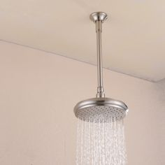 """North American Standard Ceiling Mounted Extension Shower Arm for Rainfall Shower head------ 12"""" (Length)x 0.7"""" (Diameter) Straight Shower Arm with 2.4""""(Diameter) Flange ------ Solid Brass Construction, Brushed Nickel Finished,Easily and Securely Attaches to Showerhead,Easy to install------ 1/2""""-14 NPT Male Thread Connects to the Wall,1/2""""-14 NPT Male Thread Connects to Showerhead ,US Standard,0.53-inch Thread Engagement"""