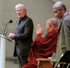 The actor Richard Gere left introduces the Dalai Lama center who spoke on the Art of Compassion today at Western CT State University in Danbury. At right is the Dalai Lama's translator Thupten Jinpa. Mara Lavitt/New Haven Register