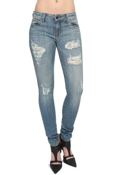 TheMogan Women's Vintage Wash Ripped & Distressed Skinny Jeans Medium 3XL. Low rise. Fade wash with destroyed detailing. Five pocket styling. Stretch for comfort. 98% cotton, 2% spandex.