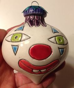 This Clown Bulb one-of-kind handcrafted sculpture is by Cuteware