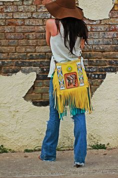 The Navi   Wild Bleu Soft, turquoise & yellow, hand cut fringe bag with custom leather indian chief skull artwork and beaded accents <3