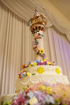 This Tangled cake includes flower details all the way to the top of the tower!