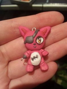 This is a chibi Foxy from the very popular game Five Nights At Freddys. She is made out of fimo clay and comes with a cord necklace. I am a big