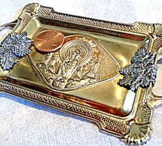 Vintage Ornate Religious Shrine Icon Tray Virgin Mary Jesus Christ (Image1)Lovely small vintage Catholic tray featuring the Blessed Mother Virgin Mary and the Child Jesus as Our lady of the Pillar. Unmarked, from France. gold and silver tone metal.