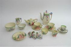 A Burleigh ware Art Deco part teaset with pink painted floral decoration and another part set by Myott painted with a crinoline lady.