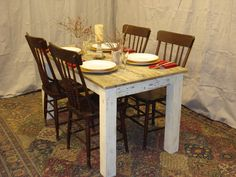 "Driftwood Dining Table (54"" x 30"" x 29""H) with Antique white distressed bottom."