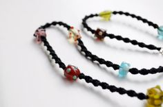 Colourful glass beads and black macrame by Seaberryaccessories, £7.50