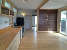Sarah House, an affordable green container home with 1 bedroom in 672 sq ft…
